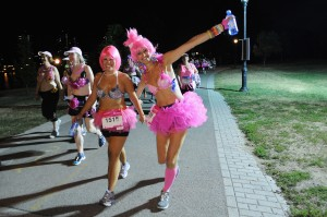 NEW YORK, NY - JULY 20:  Participants attend the first-ever MoonWalk NYC at Randall's Island on July 20, 2013 in New York City.  (Photo by Bryan Bedder/Getty Images for Walk the Walk)